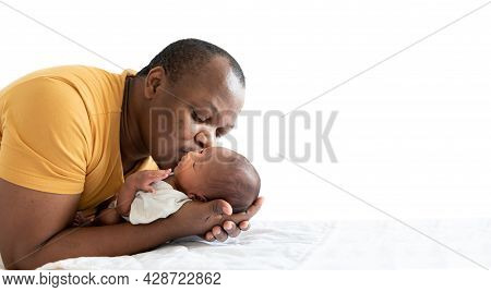 An  African American Father Kissing His 12-day-old Baby Black Skin Newborn Son, With Happy And Love,