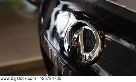 Infiniti Qx50 Chrome Brand Symbol On Polished Black Surface Of Car Trunk. Brand New Luxury Crossover