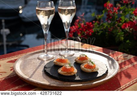 Russian Style Party With Two Glasses Of White Cold Champagne, Bliny With Red Caviar And View On Port