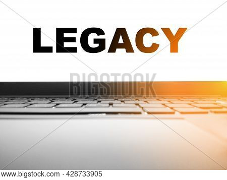 Legacy - On The Screen Of A Working Laptop In The Morning At Home