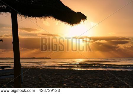 Sun Rises Over Horizon Dawn Sea. Ocean At Sunset. Sandy Beach Wave On Seashore.