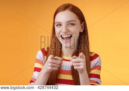 Enthusiastic Carefree Friendly Redhead Girl Pointing Finger-pistols Camera Smiling Joyfully Congratu