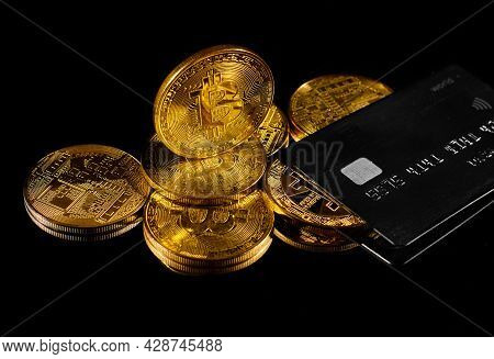 Leader In Cryptocurrency Btc And Bitcoin Rewards Card Against Black Surface. Golden Coin With Bitcoi