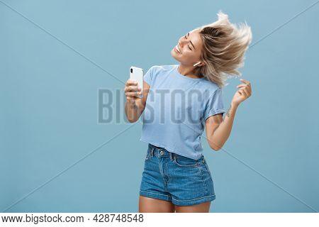 Girl Enjoying Cool Bits In Brand New Wireless Earphones Advertising Earbuds In Own Blog Recodring Vi