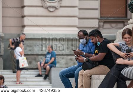 Belgrade, Serbia - July 22, 2021: Indian Tourists, Two Male Men From India, Using Their Smartphone M