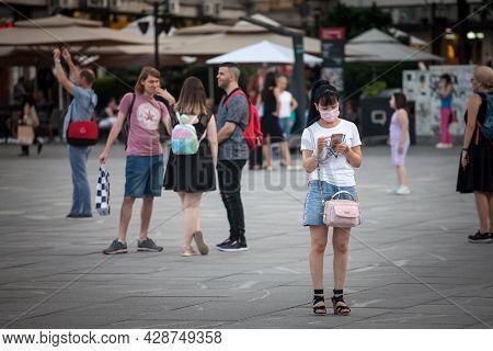 Belgrade, Serbia - June 22 , 2021: Young Asian Woman Chinese,, Tourist, Wearing A Respiratory Face M