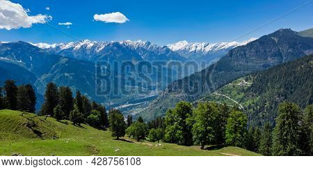 Panorama of meadow in Kullu valley in Himalaya mountains in spring. Himachal Pradesh, India