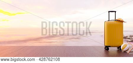 Summer Vacation Copy Space Concept, Yellow Suitcase, Beach Hat, Beach Ball On Wooden Jetty With Beau