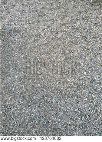 Natural Gray Granite Chippings, Macadam, Rubble Or Crushed Stones Background Top View. Macro Photo O