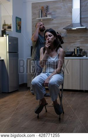 Unhappy Terrified Woman Sitting And Smoking Cigarette Feeling Miserable After Domestic Violence And
