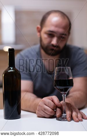 Close Up Of Bottle And Glass Of Wine Prepared For Man Feeling Unhappy And Lonely. Person Drinking Al