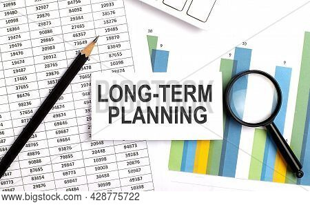 Long-term Planning Text On White Card On Chart Background