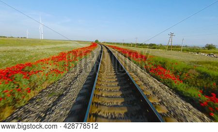 Quick Trip On Rails. Shot. Beautiful View Of Rails From Moving Train. Fast Train Ride On Rails On Ba