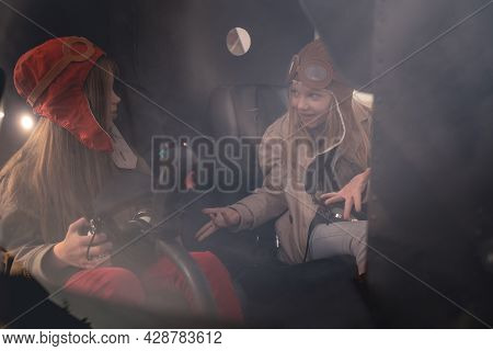 Emotional Preteen Girl Talking To Female Friend In Helicopter Cockpit