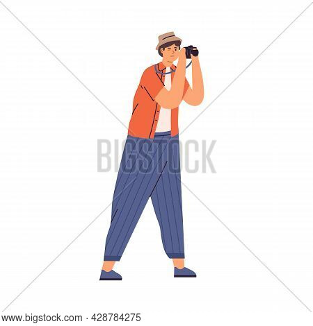 Young Tourist Holding Camera And Taking Photo During Sightseeing. Man Shooting At Trip. Travel Photo