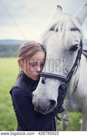 Girl With Horse. Girl Kissing Her White Horse. Friendship Between A Girl And A Horse. The Girl Is Pe