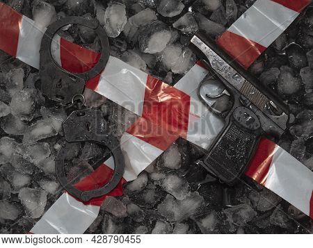 Crime Scene, Physical Evidence Against A Black Background Of Ice Cubes. The Concept Of A Hot-track I