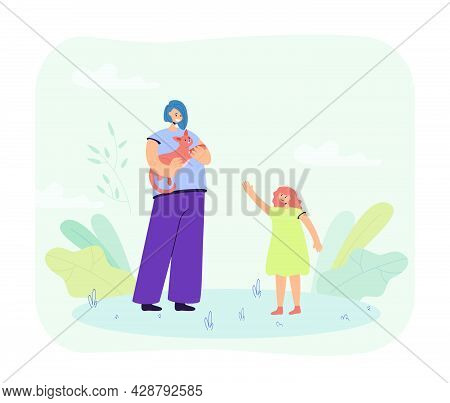 Mother Holding Cat In Hands And Daughter Standing Next To Her. Woman Stroking Lovely Pet, Spending T