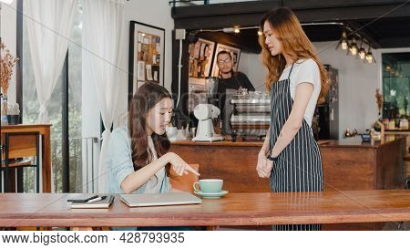 Young Asia Freelance Lady Client Talk Dispute With Millennial Waitress Feel Dissatisfied With Cafe B
