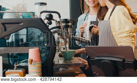 Beautiful Young Asia Lady Barista Working With Coffee Machine In Coffee Shop. Two Small Business Own