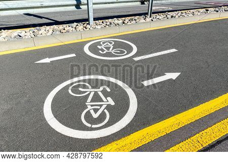 City Street Asphalt Road With Separated Two Way Direction Bicycle Lane Route Sign Mark With White Pa