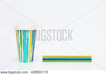 Take Away Colored Paper Coffee Cup With Plastic Cap And Paper Drinking Straws On Light White Backgro