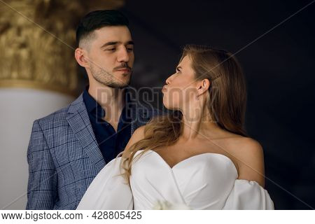Portrait Of A Young Couple In Smart Clothes. Stylish Man And Beautiful Woman Grimace And Make A Disp