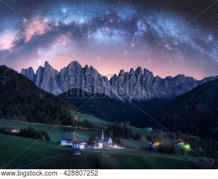 Santa Maddalena And Acrhed Milky Way At Night In Summer In Italy
