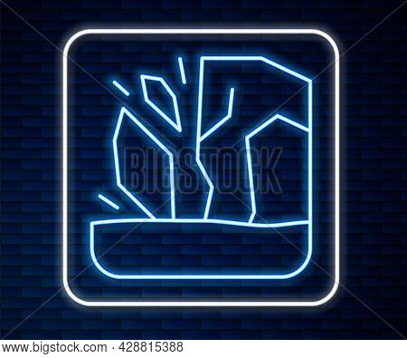 Glowing Neon Line Glacier Melting Icon Isolated On Brick Wall Background. Vector