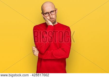 Bald man with beard wearing casual clothes and glasses thinking looking tired and bored with depression problems with crossed arms.