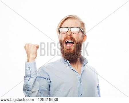 Young handsome bearded man wearing eyewear gesturing and keeping mouth open