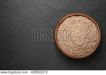 Wheat Bran On Black Table, Top View. Space For Text