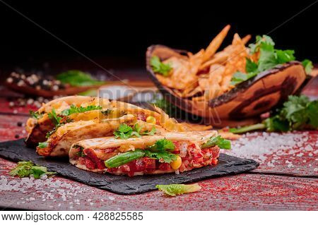 Crispy Tacos With Salsa On A Wooden Red Background. Mexican Food And Fast Food. High Quality Photo