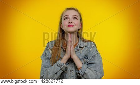 Please, God, Forgive Me. Pretty Stylish Teen Girl Sincerely Praying To God And Looking Up With Plead