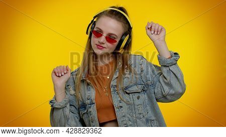 Portrait Of Teenager Girl 20s Years Old In Denim Jacket Listening Music Via Headphones And Dancing D