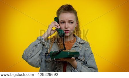 Crazy Sincere Teen Student Girl 20s Years Old In Denim Jacket Talking On Wired Vintage Telephone Of