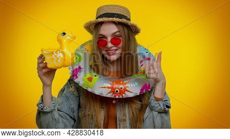 Tourist Traveler Stylish Teen Girl Dancing Fooling With Swimming Ring And Inflatable Duck Toy, Trave