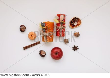 Autumn Home Decor With Candles On White Background Top View. Cozy Fall Composition. Happy Thanksgivi