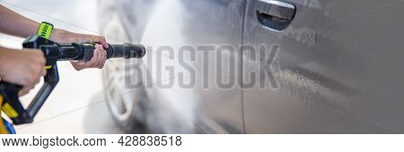 Car Wash With Water Under Pressure. Self-service, Car Wash Advertisement With Space For Copy Space O