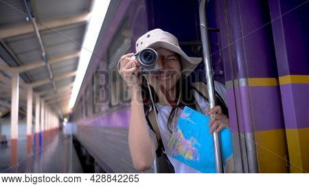 Young Girl Tourists Smile And Use Camera Take A Photo Travel Photography On The Train While Waiting