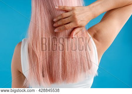 Close Up Shot Of Woman Touching Her Smooth Sleek Natural Long Pink Dyed Hair While Posing Isolated O