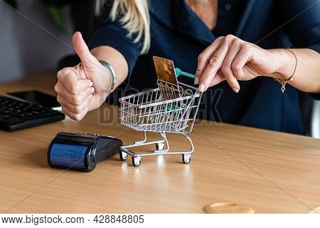 Women Hands With Mini Shopping Cart And Credit Card, Credit Card Reader And Computer Keyboard In The