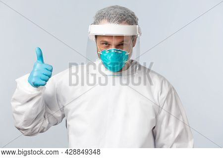 Covid-19, Virus, Healthcare Workers And Vaccination Concept. Determined And Self-assured Doctor In P
