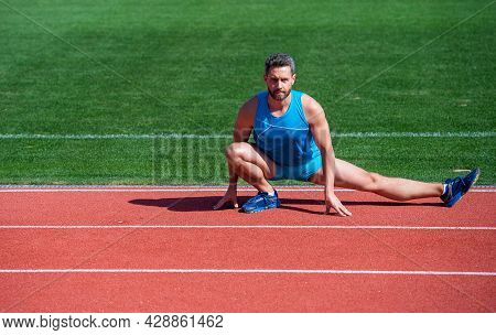 Fitness Man. Fitness Gym Outdoor. Muscular Athletic Guy Training. Sport. Male Stretch Muscles. Sport