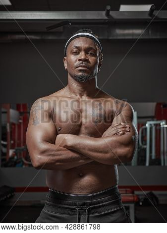 Handsome Muscular Athletic African American Man With Naked Torso Posing On Training In Gym