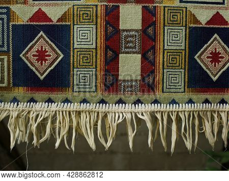 Colored Rug With Fringe Dries After Washing Close-up