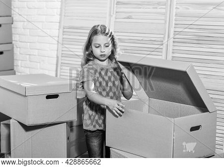 Cardboard Boxes - Moving To New House. Happy Child Cardboard Box. Purchase Of New Habitation. Happy