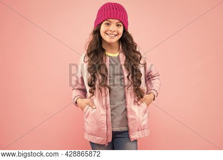 Autumn Is Here. Happy Child Smile Pink Background. Little Girl In Autumn Style. Trendy Autumn Fashio