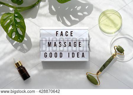 Text Face Massage Good Idea On Light Box. Lightbox On Moisturizer, Green Jade Face Roller With Exoti