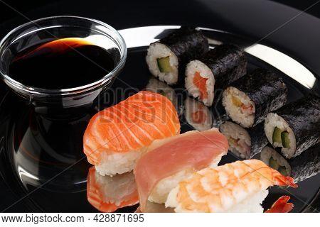 Close Up Of Sashimi Sushi Set With Chopsticks And Soy - Sushi Roll With Salmon And Sushi Roll, Delic